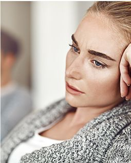 Woman staring off looking sad or concerned